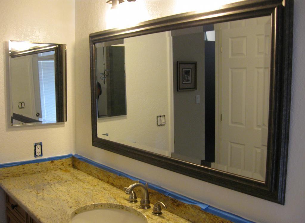 Dark framed mirror with white trim