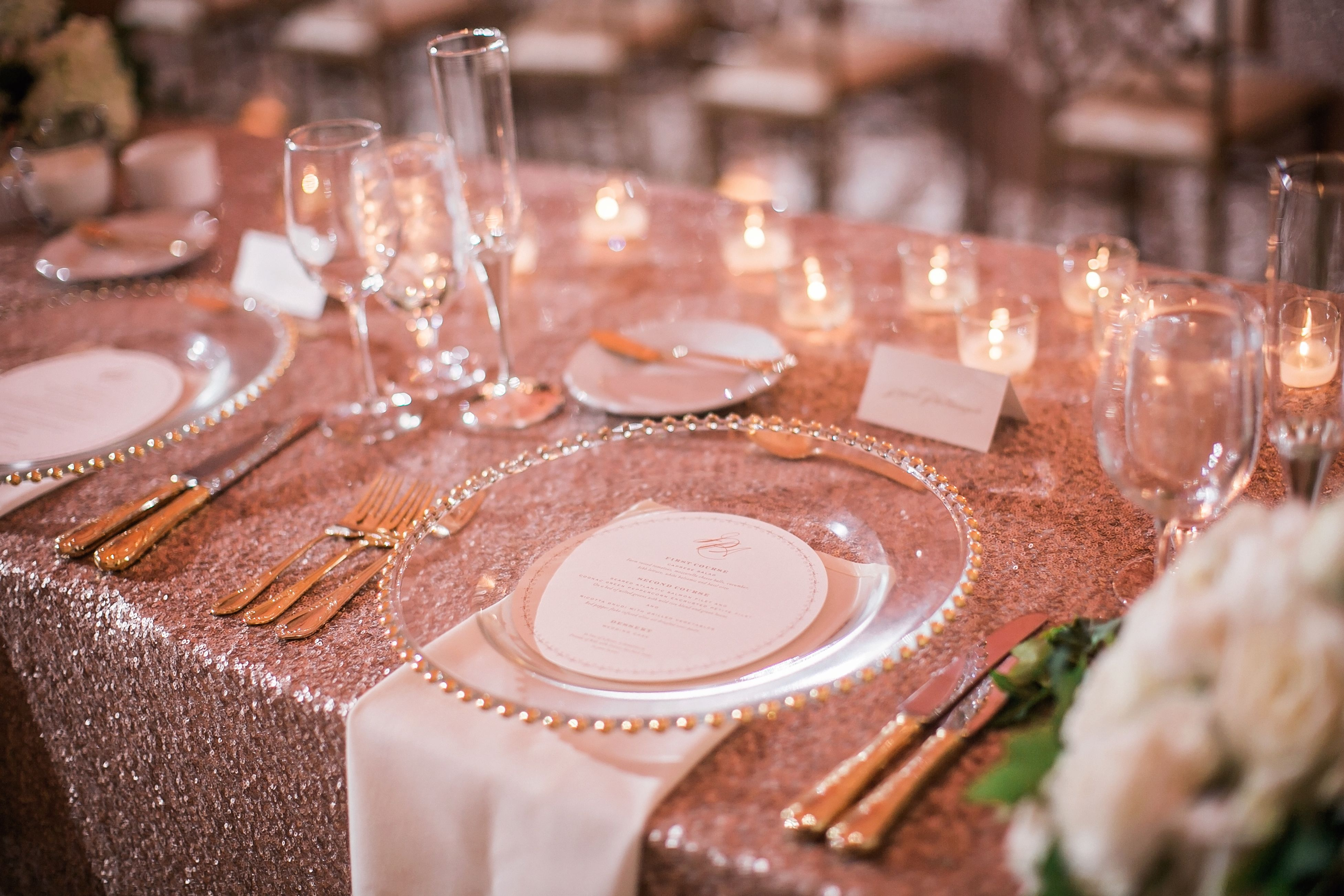 Rose Gold Linens With White Napkin And Clear Charger Plate Wedding Planner Cosmopol Rose Gold Wedding Decor Gold Wedding Decorations Rose Gold Table Setting