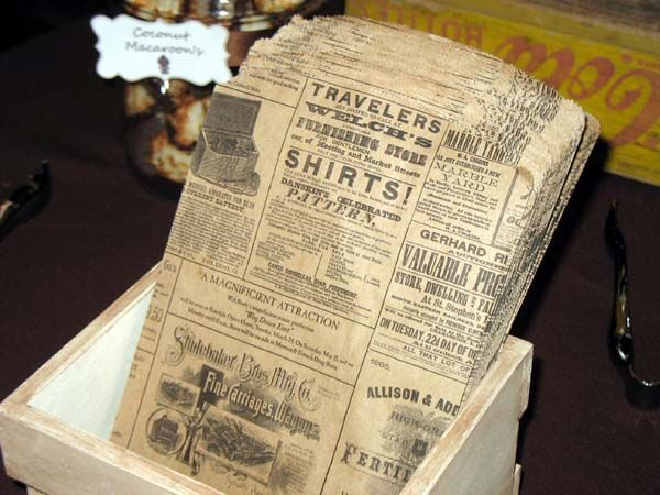 Vintage/rustic wedding theme.  Vintage candy bags with vintage ads.