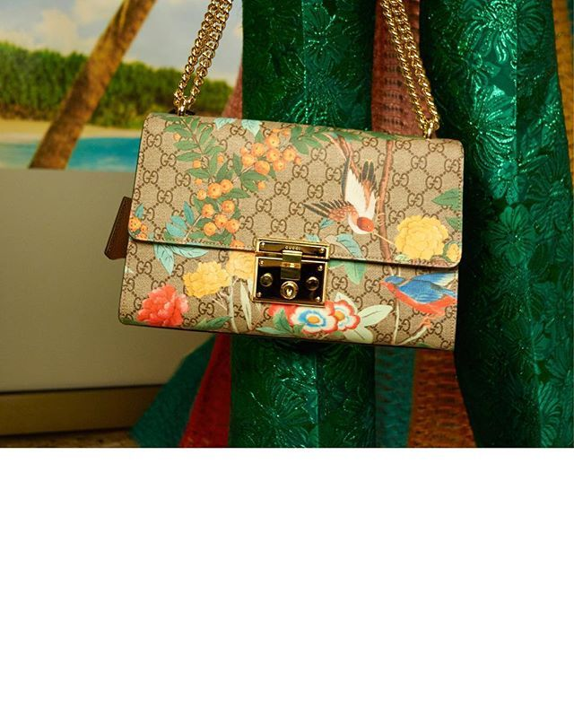 The #GucciPadlock shoulder bag in a bright new iteration, printed with #GucciTian. Featuring a sliding chain shoulder strap. #GucciSS16 #AlessandroMichele.