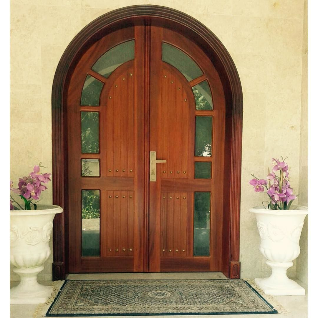Main door arch frame with double shutter   glass  Wood  Solid mahogany wood  Finish. Main door arch frame with double shutter   glass  Wood  Solid