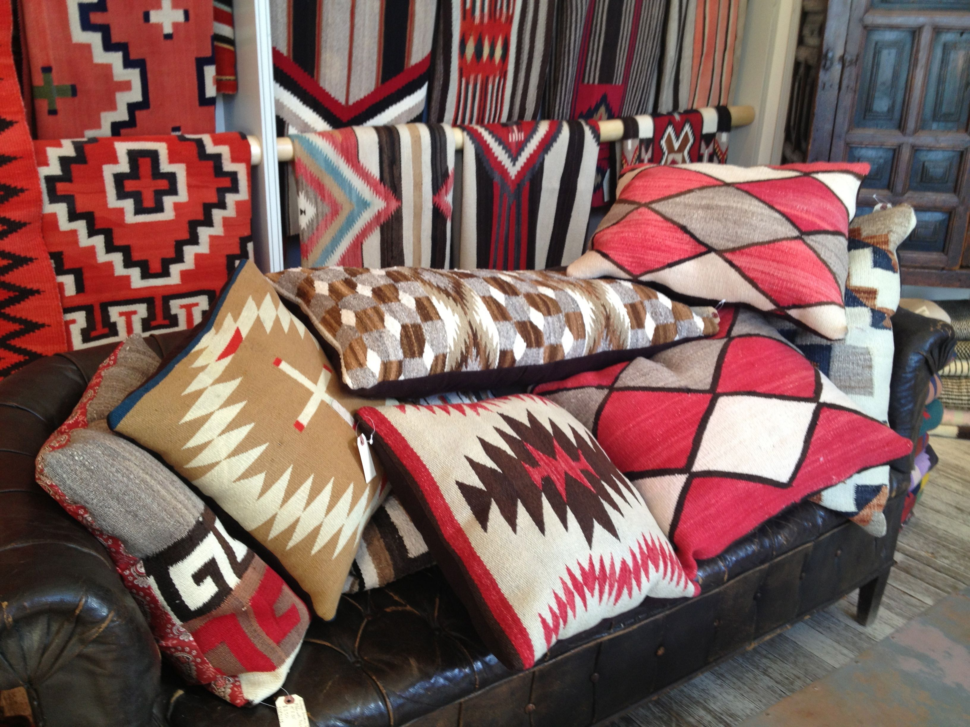 Rugs, Saddle Blankets, And Pillows All Collected On A Vintage Leather Couch  At Shiprock