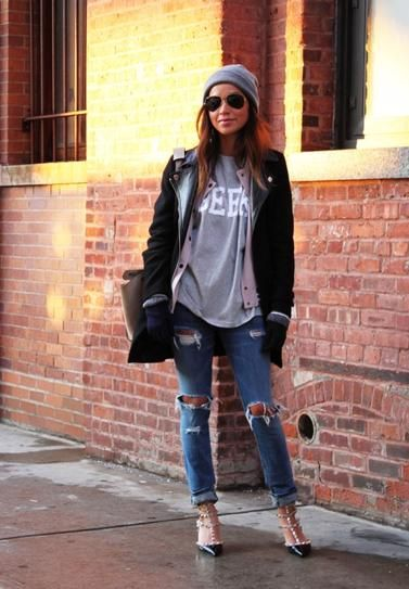 """trending: the varsity jacket - Blogger Sincerely Jules wearing an oversized varsity jacket with ripped and cuffed skinny jeans, a graphic """"Geek"""" t-shirt, gray beanie, and rock stud pointed-toe louboutin heels"""