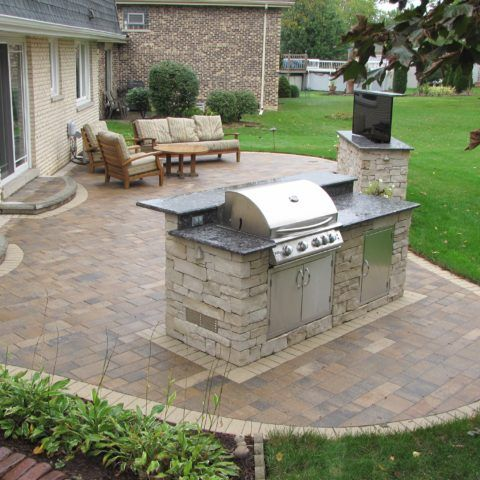 This Paver Patio Completed In Darien, IL Contains A TV Stand, And Grilling  Island. The Pavers Are Granite And Quartz Aggregates.