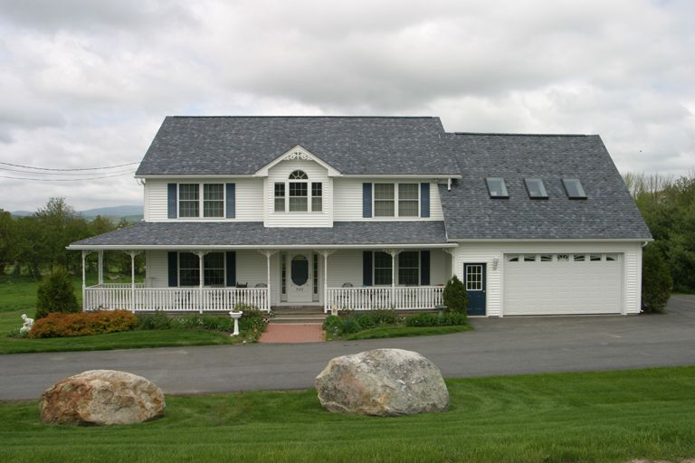 Beautiful White Colonial With Large Front Porch And Garage