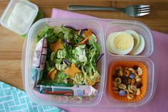 Spring Lunchbox: This spring salad has been topped with cheese butterflies and is packed with a Yoplait GoGurt, On-the-Run Cereal Snack and a hard-boiled egg.