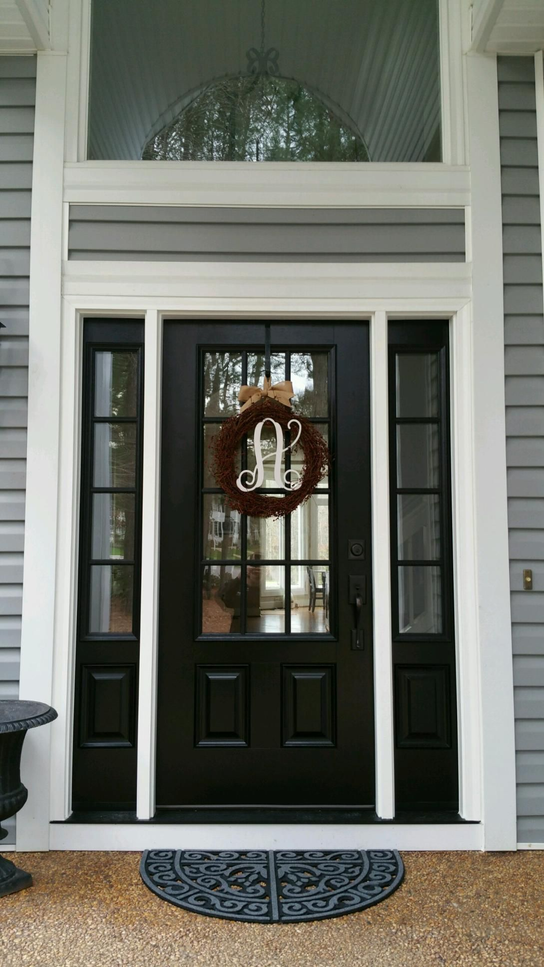 black front door with sidelightsModel 440 Signet Fiberglass Front Entry DoorCoal Black with aged