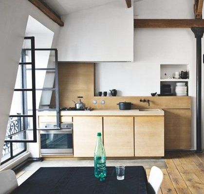 Minimal rooftop loft - via Coco Lapine Design. Compact kitchen, wood.