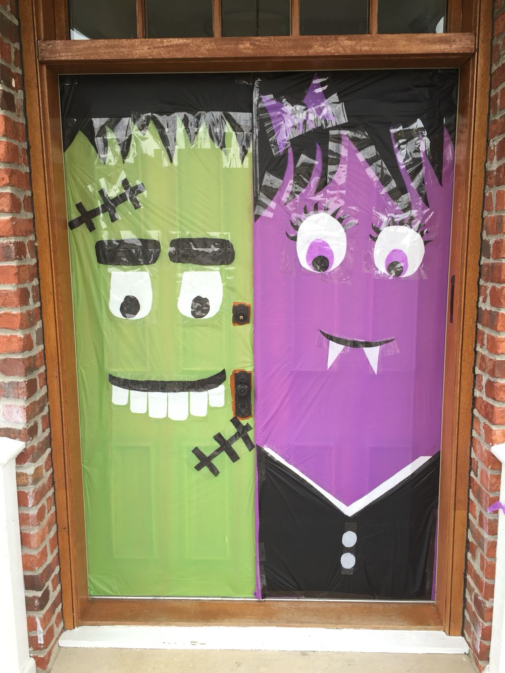 Make Halloween decoration decor with dollar store table cloths!! Vampire door and monster door for super cheap! All you need is table scissors or an exacto knife and tape :)  #halloween #doordecor  HALLOWEEN DOOR DECORATIONS :)
