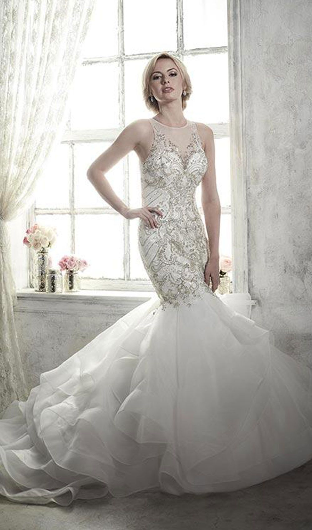 Try this fitted, trumpet wedding dress that has waves of ruffled ...