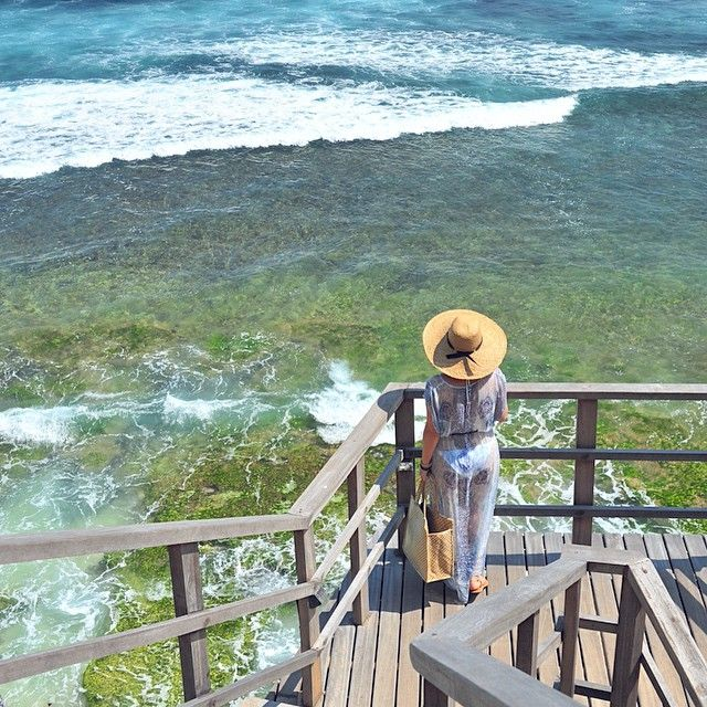 At the #Bulgari #resort on the #island of #Bali. Coming to the #beach. #Photo by @travelplusstyle http://bit.ly/1L2xOoP  #Asia #holiday #vacation #Indonesia #travel #style #travelpic #nofilter #luxury #ocean #girl #travelfashion #fashion #sea #hotel #travelhat #bulgaribali #bvlgaribali #Bvlgari by travelplusstyle