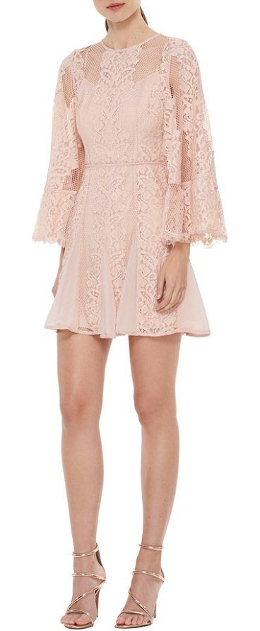 Lust over bell sleeve lace dress by la maison talulah delicate panels of lace and mesh define this playfully romantic dress made