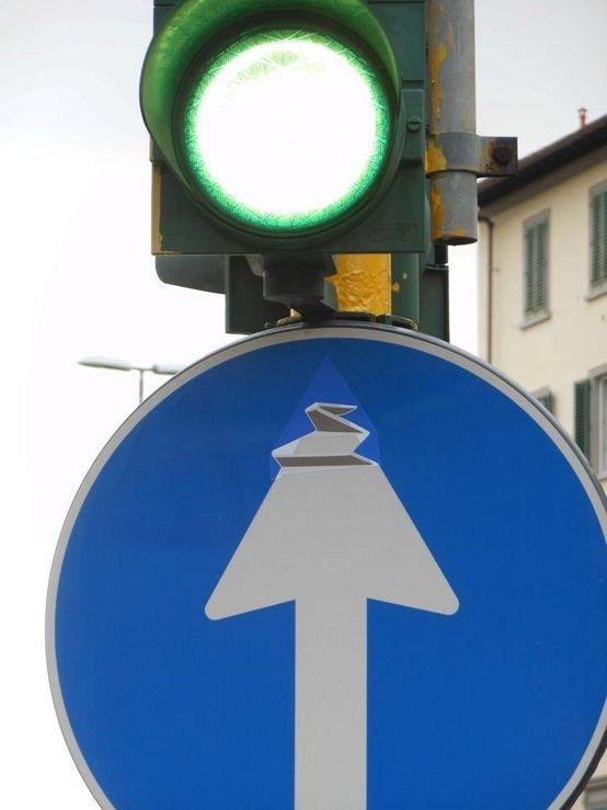 Photo of Creative way of twisting a street sign by French street artist Clet Abraham: www…