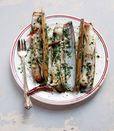 Razor clams take well to quick-cooked preparations like this one, a popular order at Bar Pinoxto, a tapas counter in Barcelona's covered market.