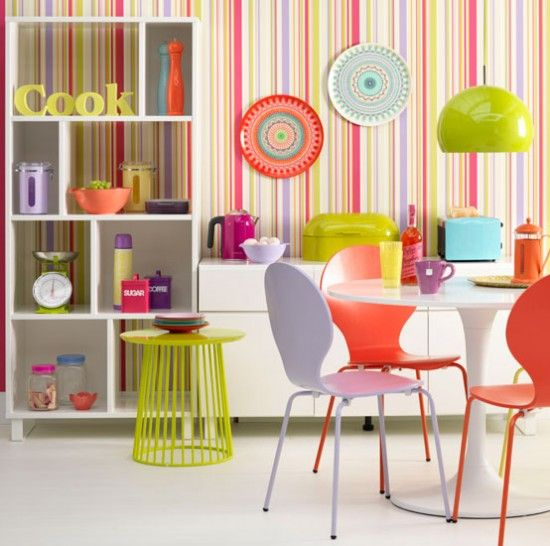 Fluoro-bright kitchen-diner  This colourful kitchen-diner is one for the brave-hearted, but its bright finish will lift your mood on even the greyest day. The trick is to use enough neutral tones and colour blocking — check out the dining furniture — to avoid the finish becoming too fussy.
