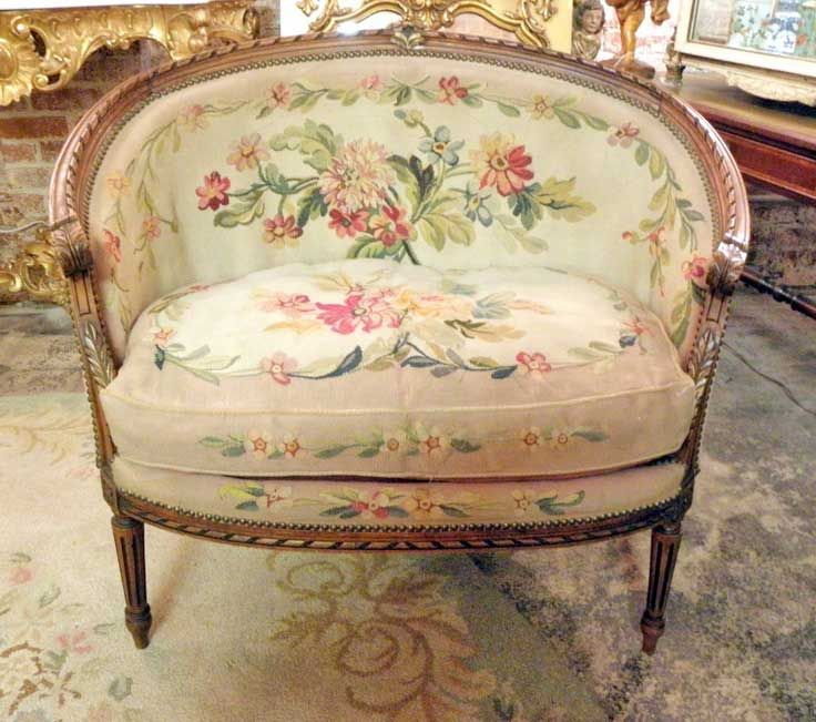 antique needlepoint settee in floral on blush pink background