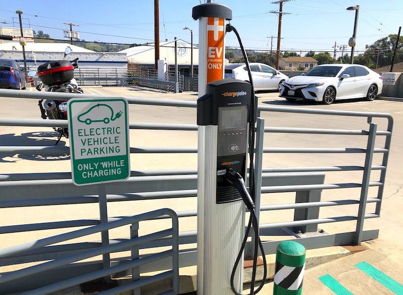 Electric Car Chargers Downtown Los Angeles Condos With Ev Charging Station In 2020 Electric Car Charger Ev Charging Stations Ev Charging