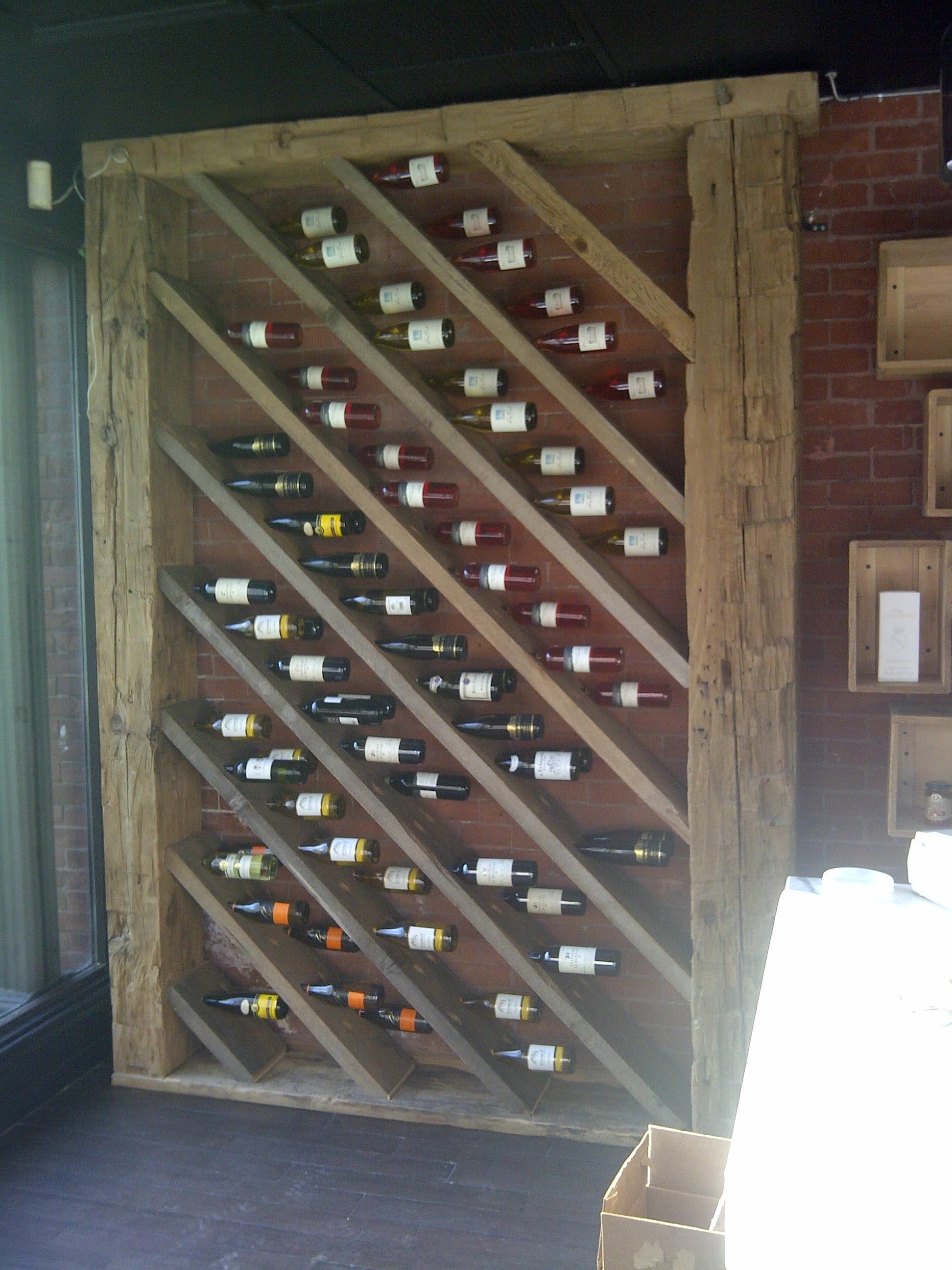 Capacity for about 100 bottles of wine. 9.5' tall.  Looks right at home against the 120 year old brick wall.