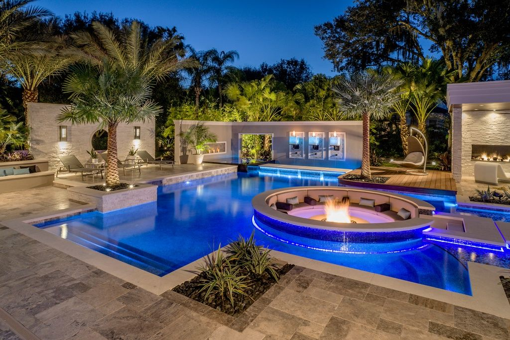 Modern Swimming Pool with Pathway, exterior stone floors, Raised beds, exterior tile floors, Fire pit