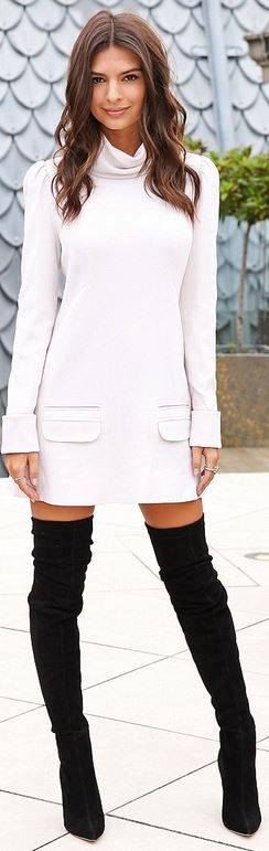 Who made Emily Ratajkowski's jewelry, white long sleeve dress and black thigh high boots?
