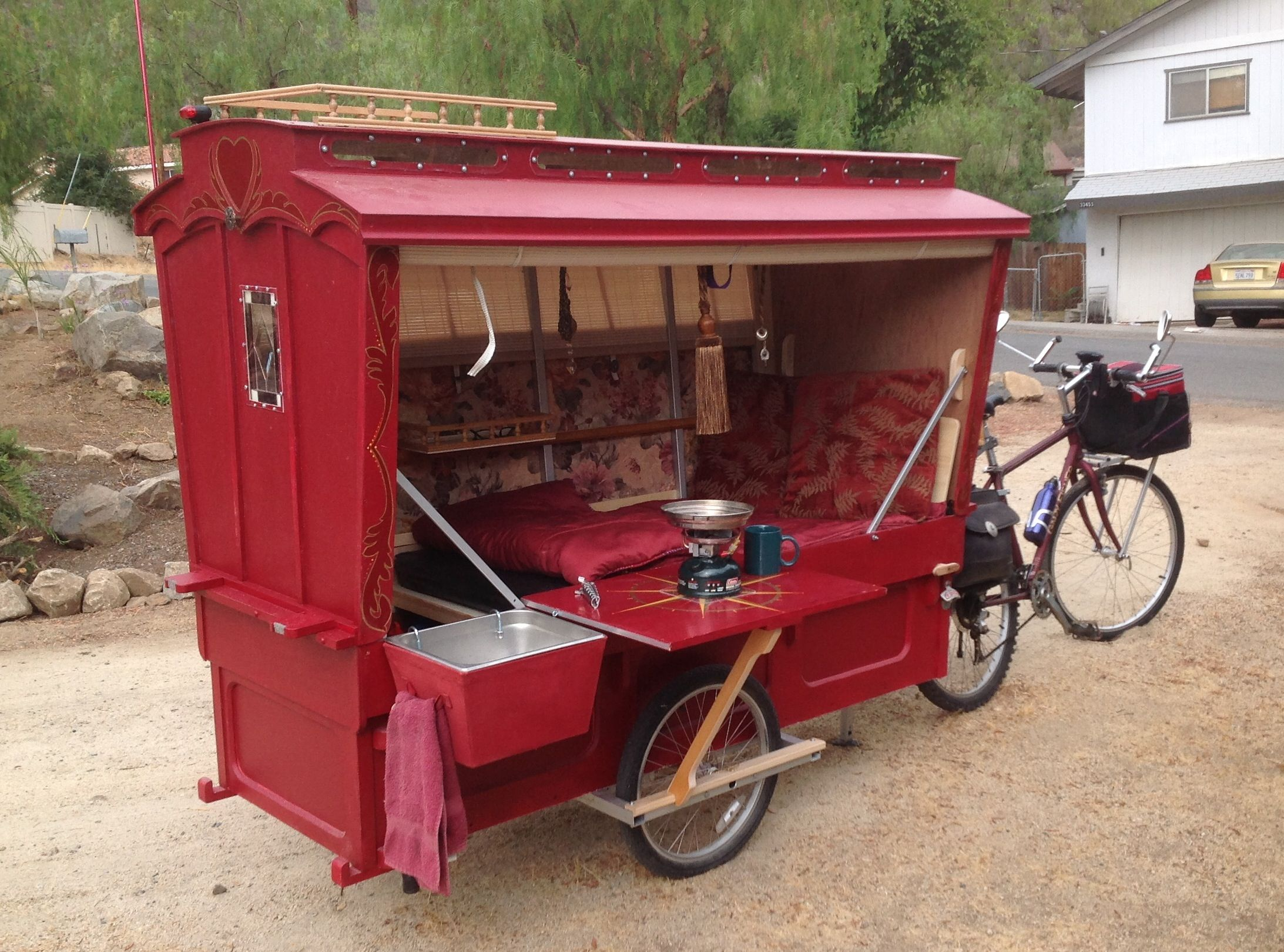 micro gypsy caravan with outdoor galley set up sink stove table