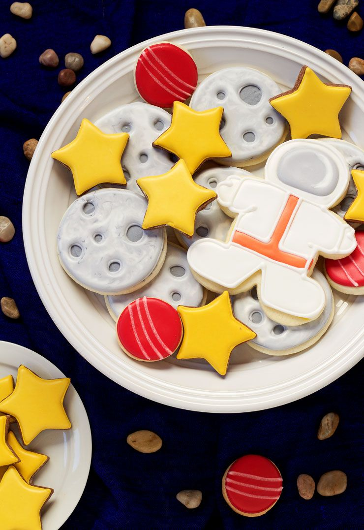 Outer Space cookies are simple sugar cookies that are decorated with royal icing. The astronaut is made from a simple gingerbread man cookie cutter.
