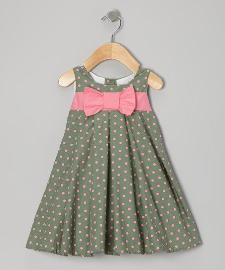 752d1784b2b6 Two great colors on one great dress. Pink and green spots pop off a swing  silhouette for a garden-fresh look and feel.