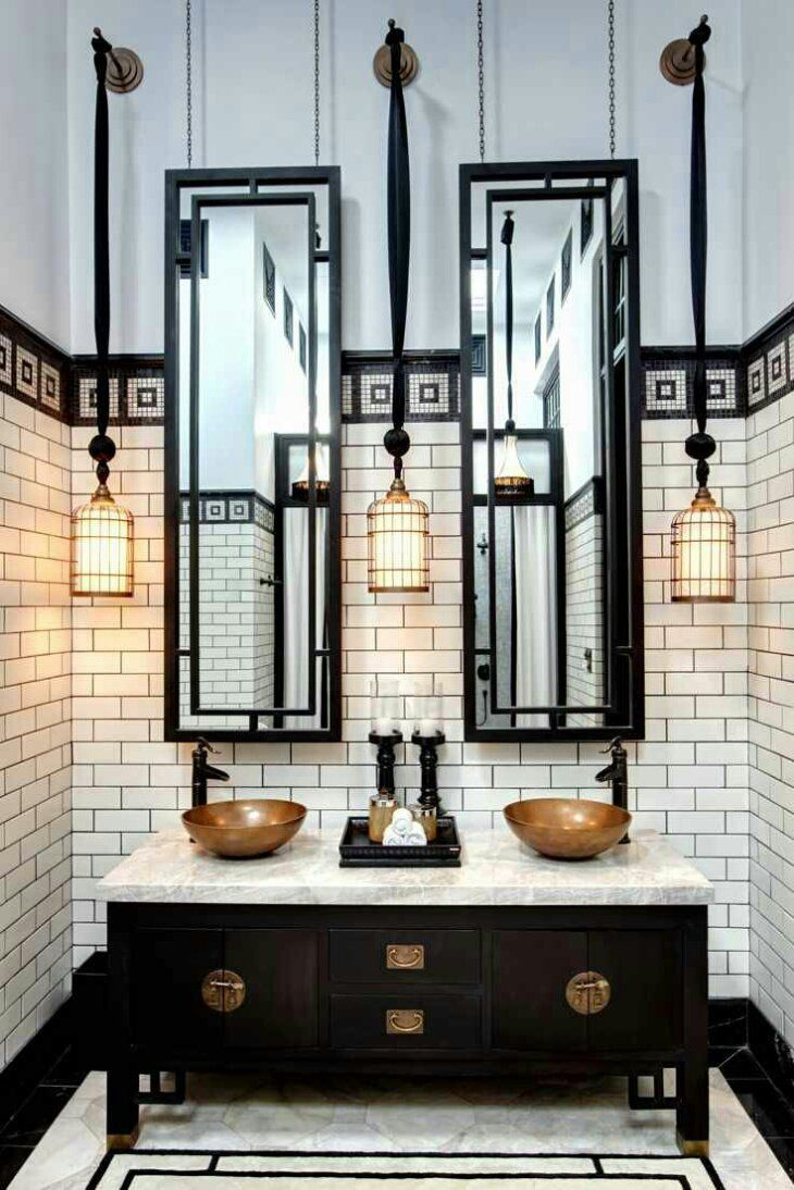 White tiles black grout bathroom - Photos If Incredible Hotel Bathrooms Black And White Industrial With White Subway Tiles Double Vanity Sink With Brass Accents Wire Pendant Light