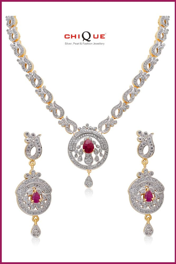 Abstract CZ necklace set will surely make you popular in any occasion. It is studded with CZ, AD, golden and rhodium polished alloy in abstract motif. The semi-precious Ruby in the middle of the pendant will attract every one. Matching earrings are available