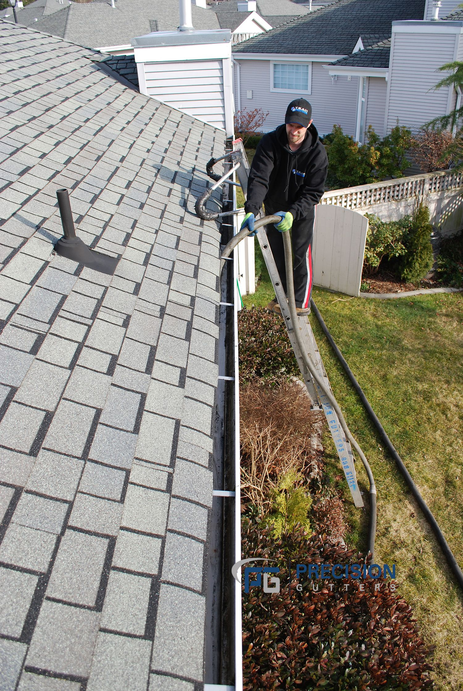 One Of Our Gutter Technicians Cleaning Gutters On A Beautiful Spring Day Gutter Accessories Cleaning Gutters Gutters