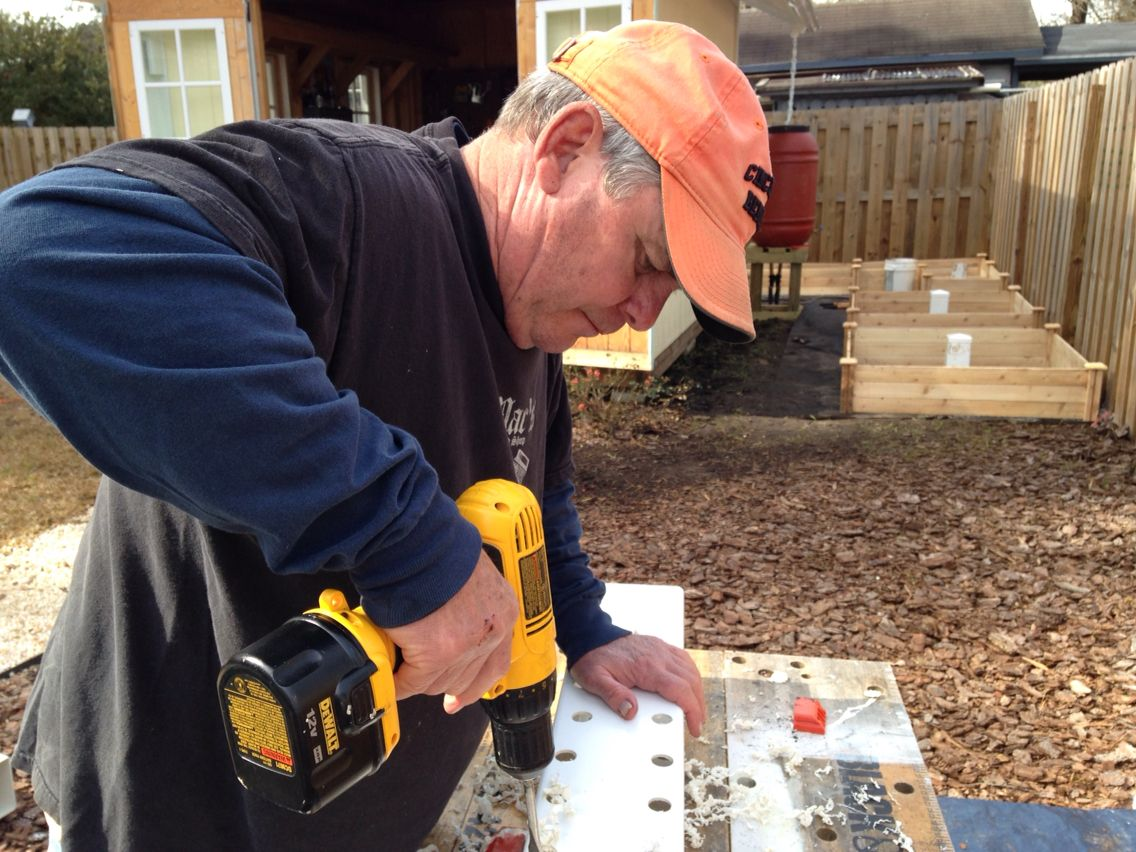 Hubby drilling hundreds of holes for my worm towers!