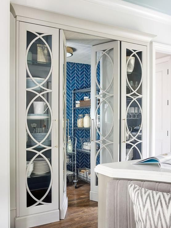 Ivory eclipse mullion built in china cabinets flank a matching ...