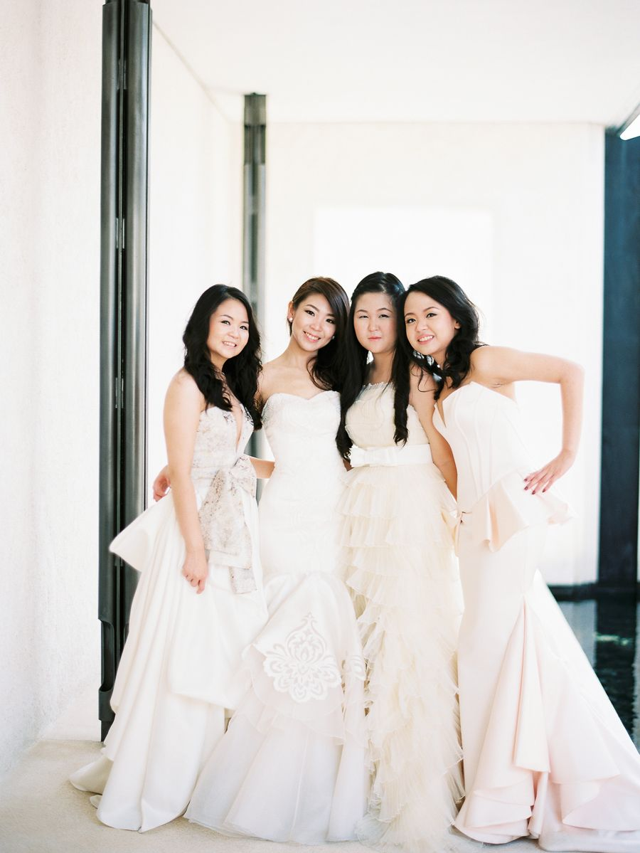Bridesmaids in all white dresses ethereal white wedding at alila