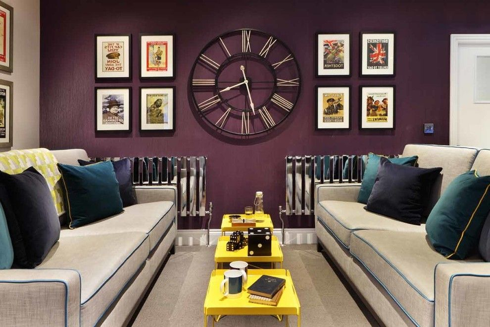 target clocks living room bohemian design bedroom wall large clock frame surrounding by eight printed picture in black hanging on the purple painted