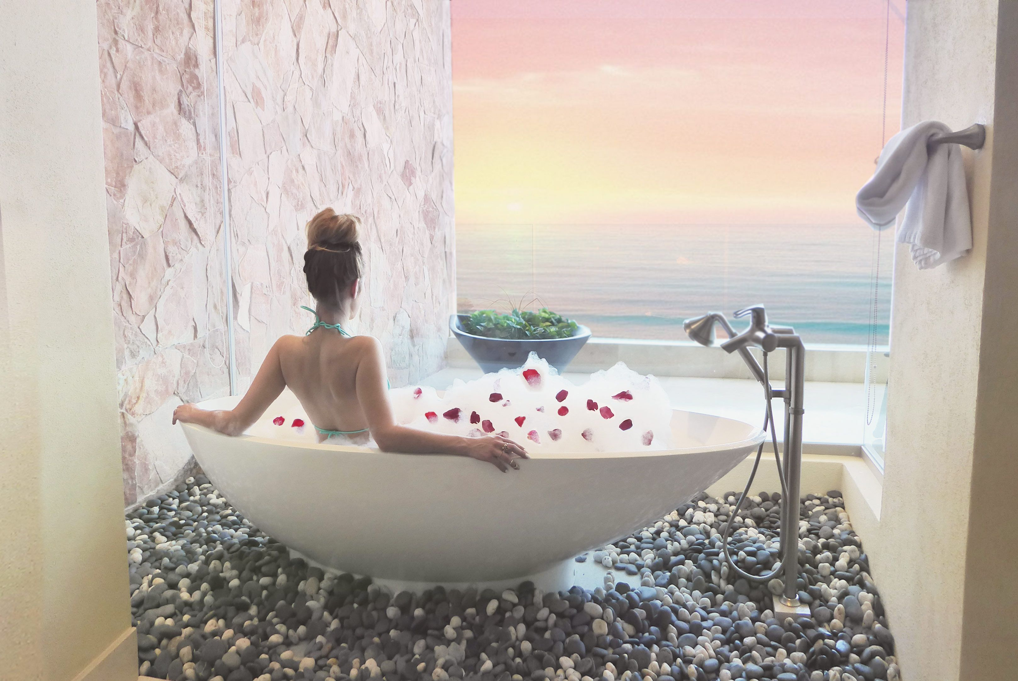 Relaxing in a beautiful bathtub with bubbles and rose petals in ...