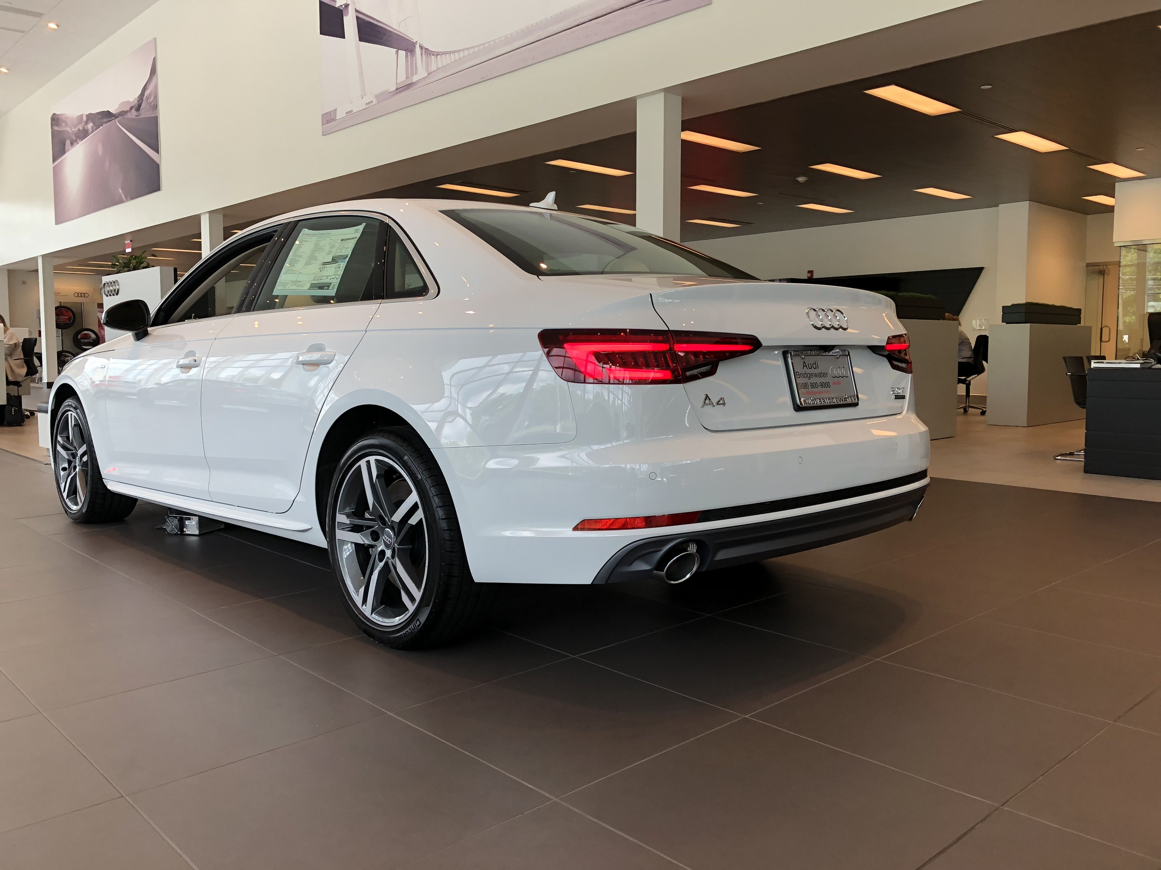 Rear Low Angle View Of The Ibis White 2018 Audi A4 Located At Audi Of Bridgewater Nj Small Luxury Cars Audi Audi Dealership