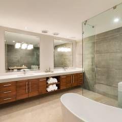 Baño principal: Baños de estilo translation missing: mx.style.baños.moderno por Juan Luis Fernández Arquitecto