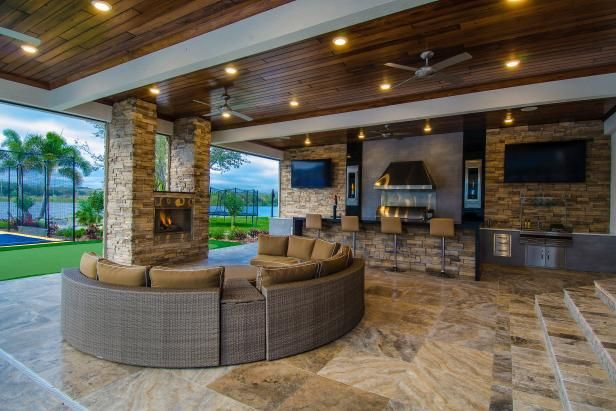 Covered Patio Boasts Cozy Seating Area And Outdoor Kitchen