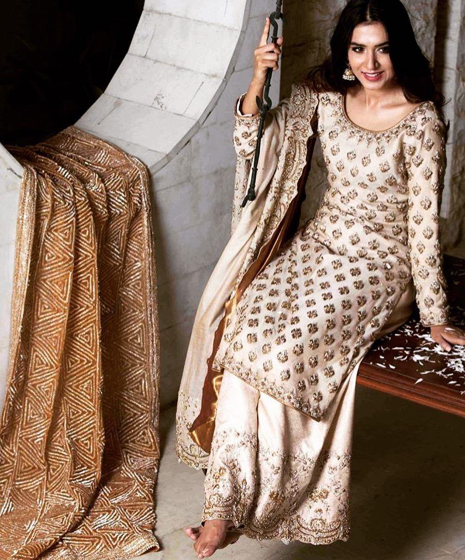 2c80ce21f9 sharara or lengha ivory gold Pakistani Dresses