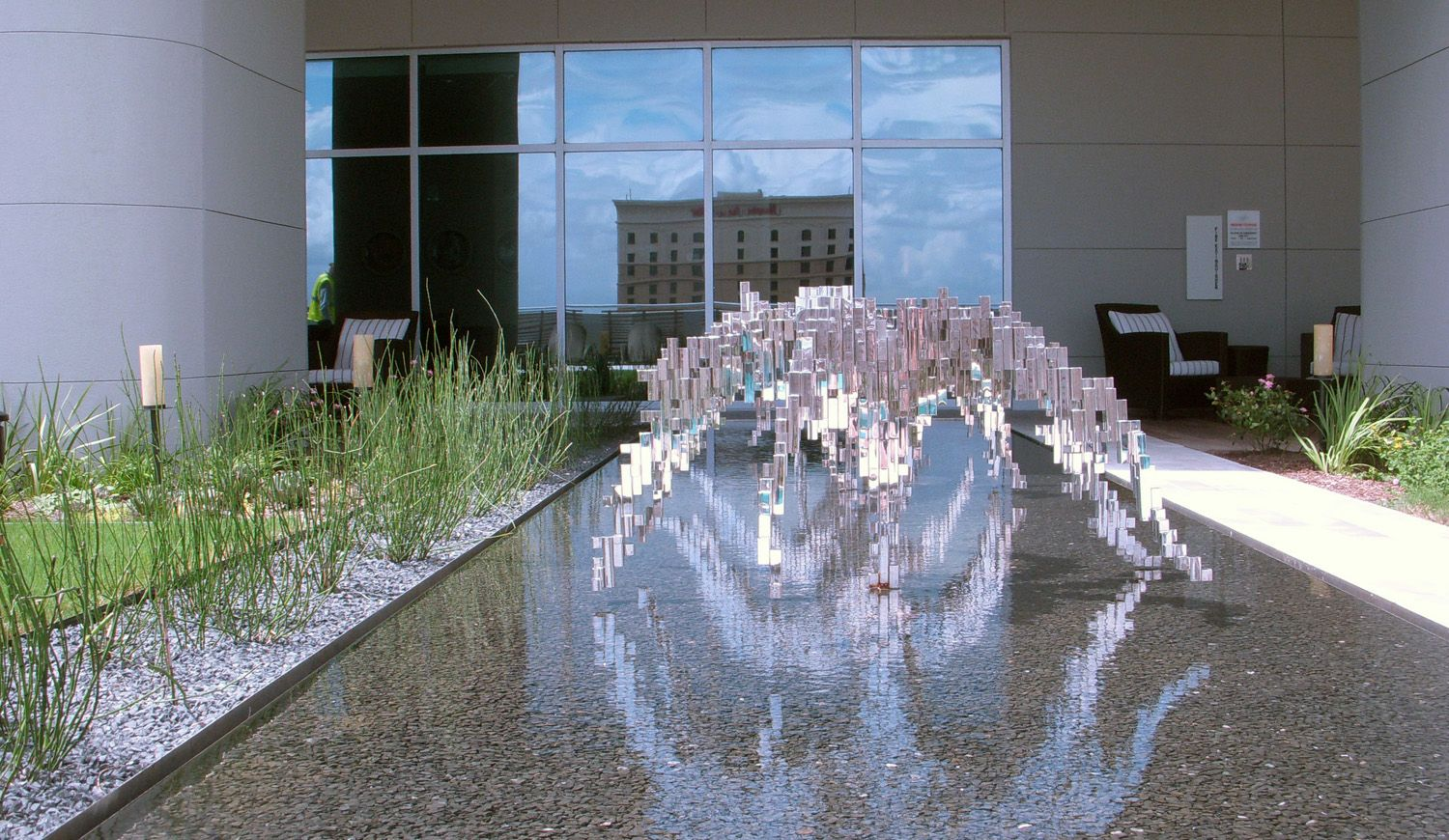 The Austonian, Austin, TX. I designed the planting...and wish I had met the artist.