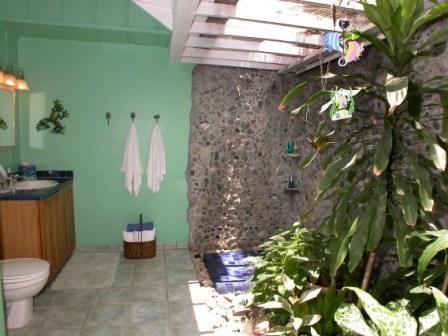 Spacious bathroom with stonework in Caribbean