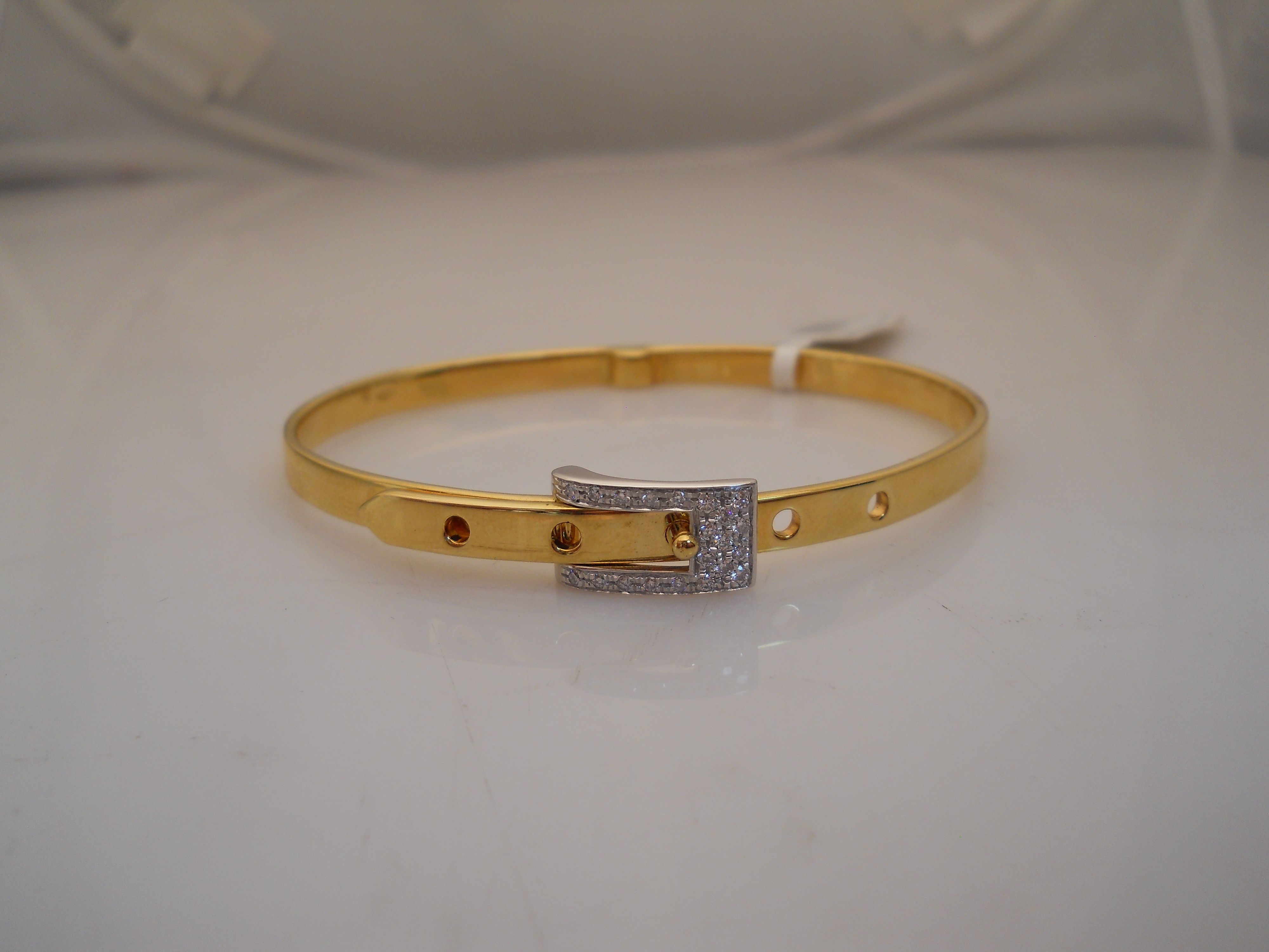 """18 karat yellow and white gold """"Buckle"""" bracelet $1,395  (call us for more info toll free at 1-877-422-7979)"""