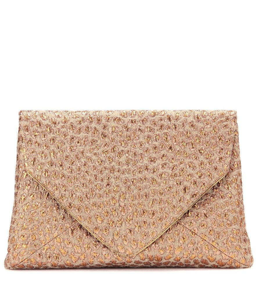 Dries Van Noten - Jacquard clutch - Dries Van Noten found inspiration in the sumptuous wealth of Italian aristocracy this season. Here, the designer's envelope-shaped clutch has the same air of effortless impact that made the socialites of yore legends in their own right. A rich jacquard copper-toned weave makes this the perfect textured piece for accompanying your LBD. seen @ www.mytheresa.com