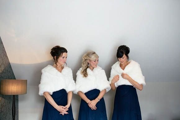 Bridesmaids In Navy Blue And Fur Wraps For A Winter Wedding Http