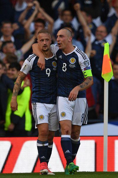 Scotland S Striker Leigh Griffiths Celebrates With Midfielder Scott Brown R After Scoring Their