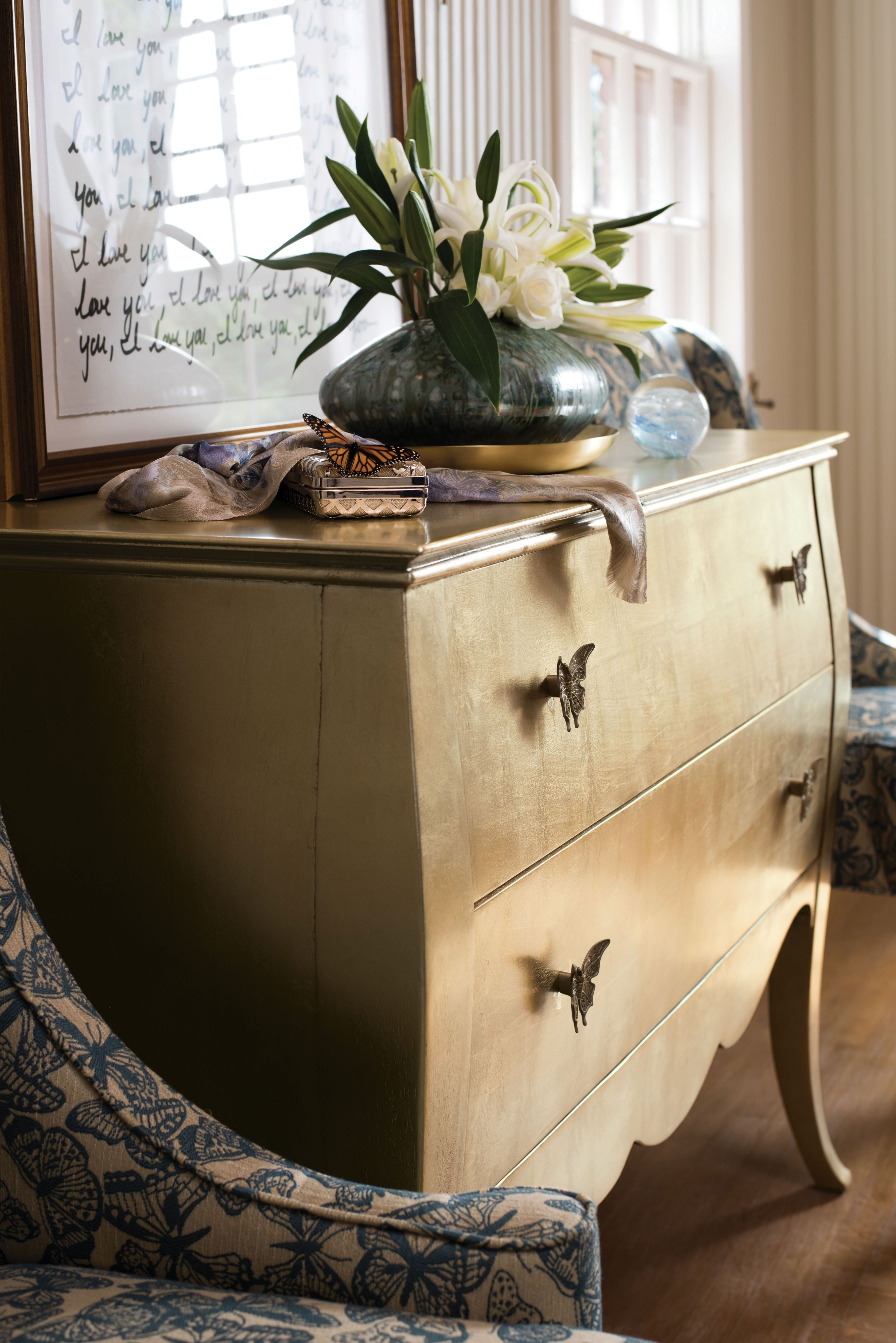 Butterfly chest with a gold leaf finish. Thomasville