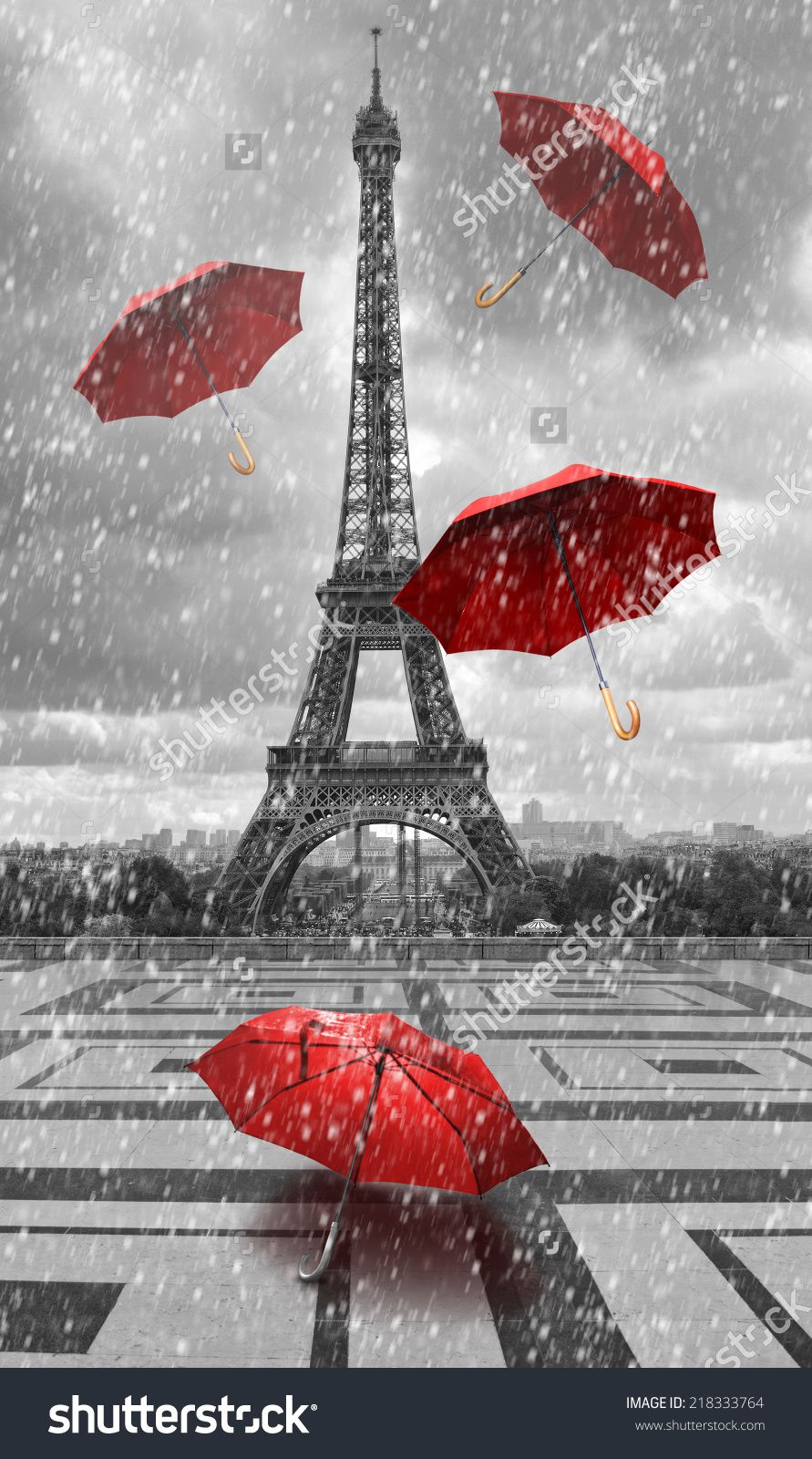 Eiffel tower with flying umbrellas. Black and white with ...