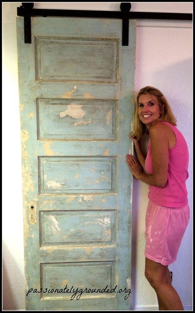 Turn A Regular Door Into A Sliding Barn Door Diy Barn Door Doors Repurposed Barn Doors Sliding