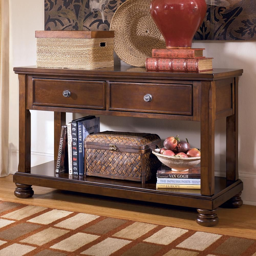 Porter sofa tablemedia console by signature design by ashley add rustic style and function to your living room with the sofa tablemedia table geotapseo Choice Image