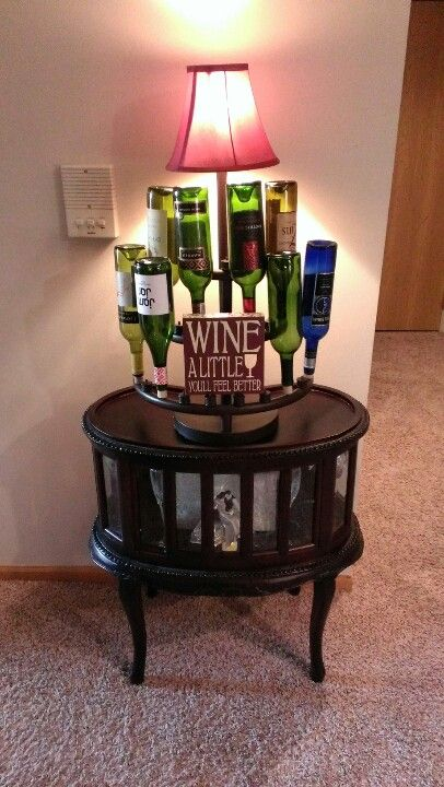 A wine bottle tree made into a lamp